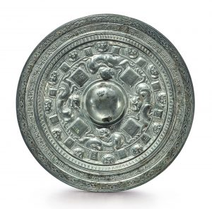 A SILVERED BRONZE 'BEAST' INSCRIBED MIRROR EASTERN HAN DYNASTY, DATED TO THE THIRD YEAR OF ZHONGPING, CORRESPONDING TO 186 AD