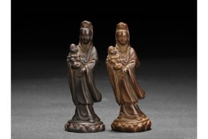 TWO CARVED GUANYIN FIGURES