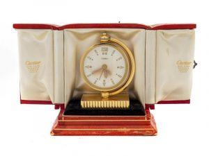 A Cartier Art Deco 18K Traveling Desk Clock