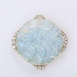 Carved moonstone and diamond brooch set in platinum  Diameter: 2 inches  By Tiffany & Co., ca. 1905  Exhibitor: A La Vieille Russie, Inc