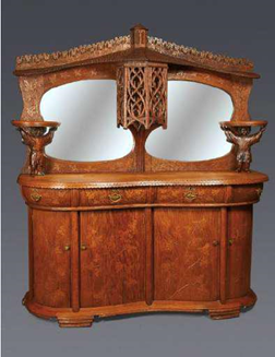 """Magnificient dining room suite composed of a carved oak sideboard (pictured), table, and six chairs  Circa 1900  A one of a kind suite commissioned for a """"cottage""""  in the Pennsylvania resort town of Eagles Mere   Exhibitor: Kelly Kinzle"""