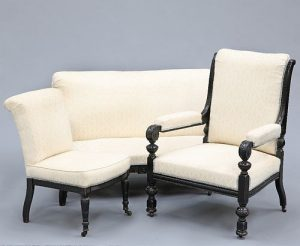 A VICTORIAN EBONISED AND UPHOLSTERED PARLOUR SUITE
