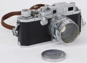 Canon Model IV S 35mm SLR camera, circa 1952-1953, including neck strap, skylight filter and lens cap, plus one Serenar