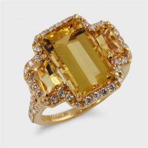 A yellow beryl, diamond, and eighteen karat gold ring