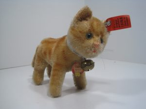 Steiff mid-1920s mohair marmalade Tabby cat with period ID including her button, ear tag, and chest tag; image from the collection of Rebekah Kaufman.