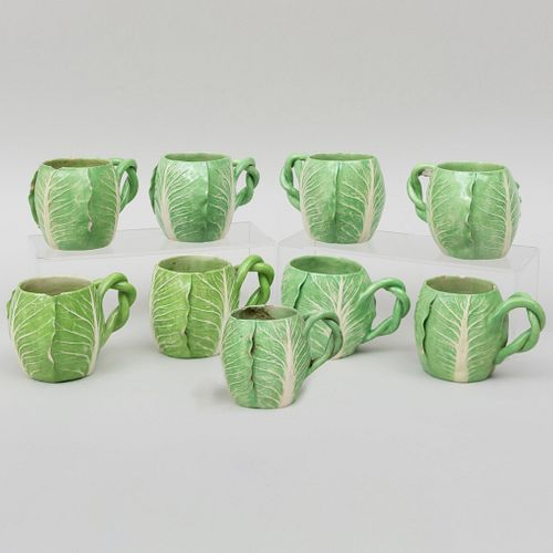 Nine Dodie Thayer porcelain lettuce mugs. Photo by Stair Galleries.