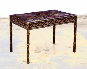 Early 19th century Chinese Export black and gilt lacquer games table, having a top with four counter recesses, the reticulated frieze fitted with a single drawer (est. $1,200-$1,800).