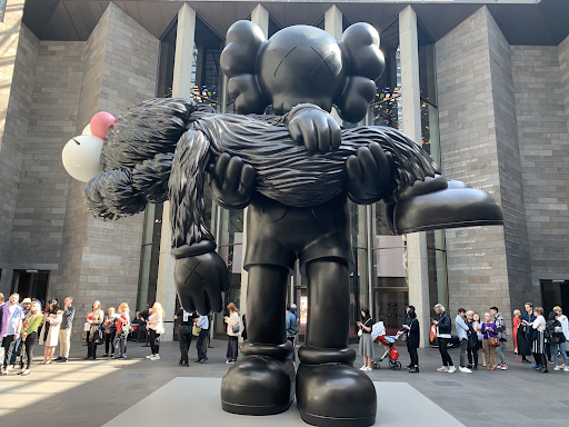 GONE. 2019. Patinated and painted bronze KAWS sculpture commissioned by the National Gallery of Victoria. Image from Dean Sunshine, StreetArtNews.net