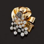 A 18K two-color gold and diamond brooch