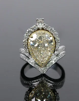 18K WG Custom 3.75 CTTW Fancy Yellow Diamond Ring available in Gallery 63's June 28th estates auction. Photo courtesy of the auction house.