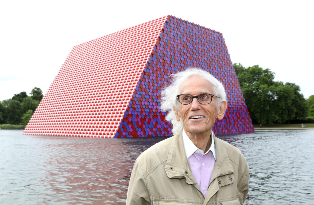 Christo with his installation on Serpentine Lake in London, England. Image from Serpentine Galleries.