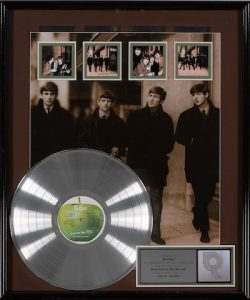 A BEATLES FOUR-TIMES PLATINUM DISC AWARD FOR THE BEATLES LIVE AT THE BBC