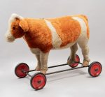 Riding toy cow. Germany. Twentieth century. Steiff brand. Made of plush. Supports with wheels