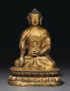 A GILT REPOUSSÉ BRONZE FIGURE OF BUDDHA