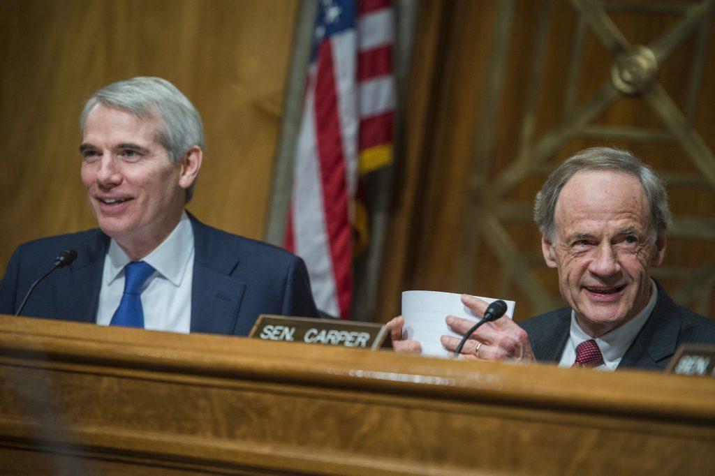 Senators Rob Portman and Tom Carper at a 2017 Senate hearing. Image from Artnet News