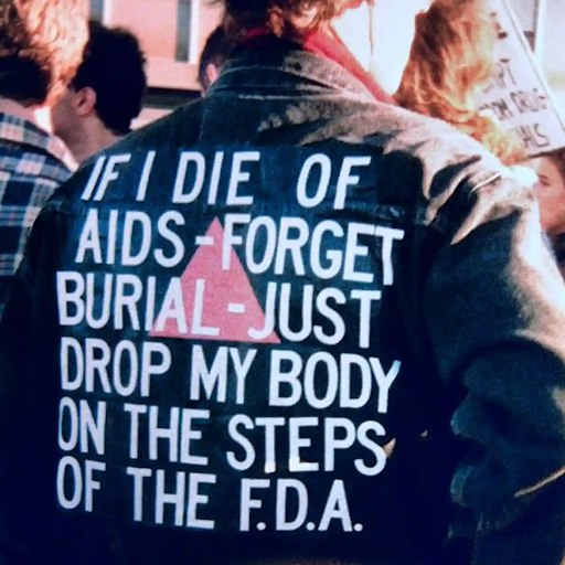 David Wojnarowicz at an AIDS demonstration in 1988. Image from The Guardian.