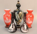 Five glass vases to include pair of amethyst Mary Gregory vases, pair of red Mary Gregory case glass vases having scene with boy holding a balloon