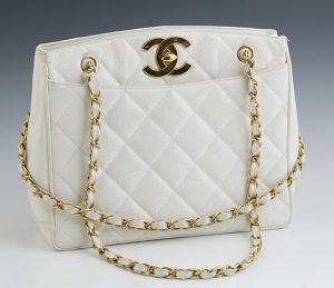 Chanel White Caviar Quilted Leather Shoulder Bag, c. 1985, with gold tone chain-link woven leather double straps, the CC turn-lock