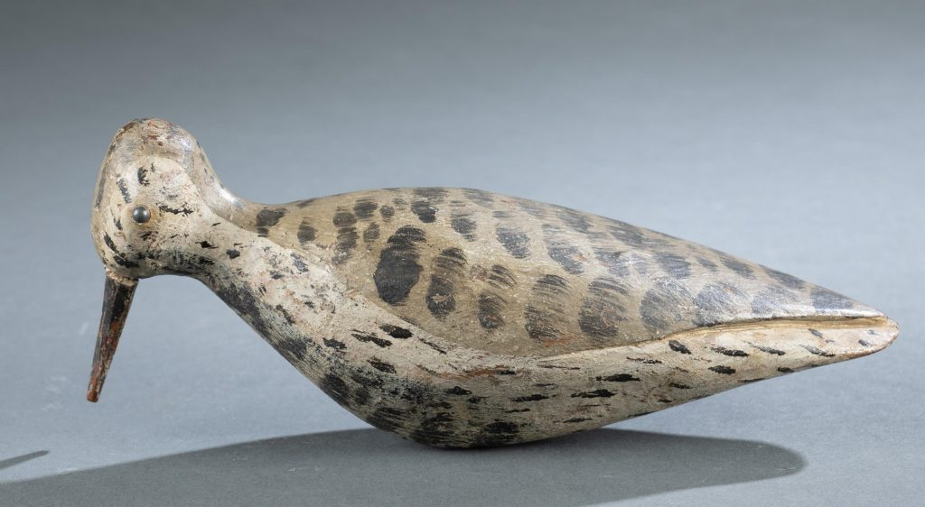 Black-bellied plover decoy, unknown maker, mid 19th century, 9½in long. Desirable primitive look with unusual head-form and iron-nail bill. Original paint with minor in-use loss. Stamped 'W.J. Mackey Collection.' Estimate: $2,000-$3,000