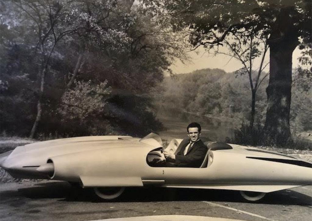 Vintage photo of John Bucci (Italian/American, 1935-2019) at the wheel of 'La Shabbla,' the concept car he created circa 1960-62. Archival photo from the Estate of John Bucci