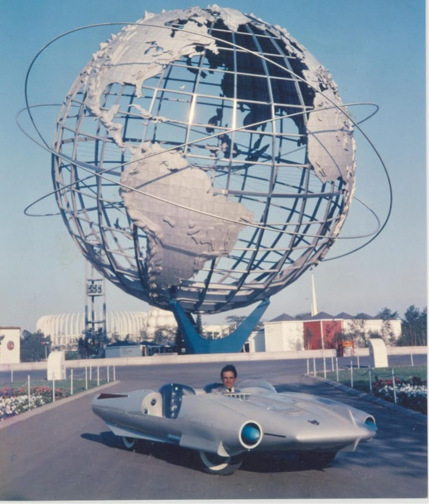Concept car designer/fabricator John Bucci (Italian/American, 1935-2019) at the 1964 New York World's Fair, where his 1962 fiberglass car 'La Shabbla,' thrilled millions of visitors at the Cavalcade of Cars exhibition. The car is entered in an online-only auction with bidding through October 14. Estimate $50,000-$75,000. Archival photo from the Estate of John Bucci.