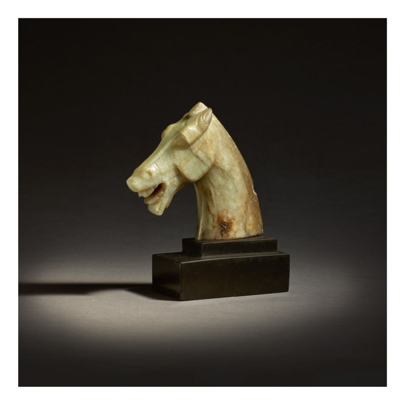 Celadon and russet jade horse head. Image from Sotheby's.