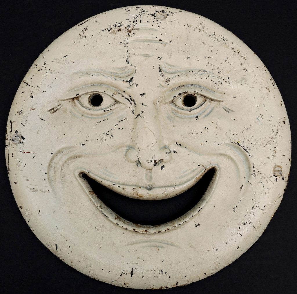 Only known example of H.C. Evans Company's cast-iron Man in the Moon shooting gallery target, 15in diameter, wonderful expression and dimensional detailing not typically seen on targets. Illustrated in an Evans catalog. Estimate $6,000-$8,000