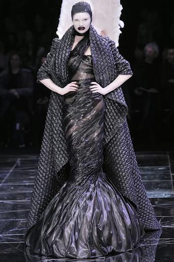Alexander McQueen, quilted dark gray silk blend coat from Horn of Plenty, Autumn/ Winter, 2009. Image from Vogue.