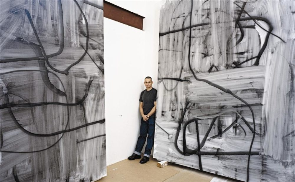 Christopher Wool with his paintings. Image from Interview Magazine.