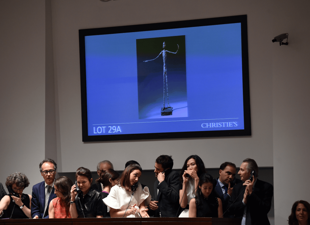 Christie's auction offering Giacometti's L'homme au doigt. Photo by Timothy A. Clary for Getty Images.