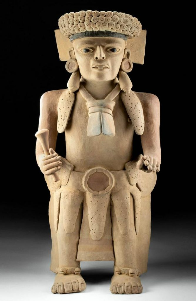 Monumental circa 400-700 CE Veracruz (Mexico) hollow-form terracotta figure of a dignitary, 28.125 inches tall, finely hand-built and modeled with distinctive facial details, a headdress, large earspools, and jingle-bell anklets. Estimate $22,000-$33,000