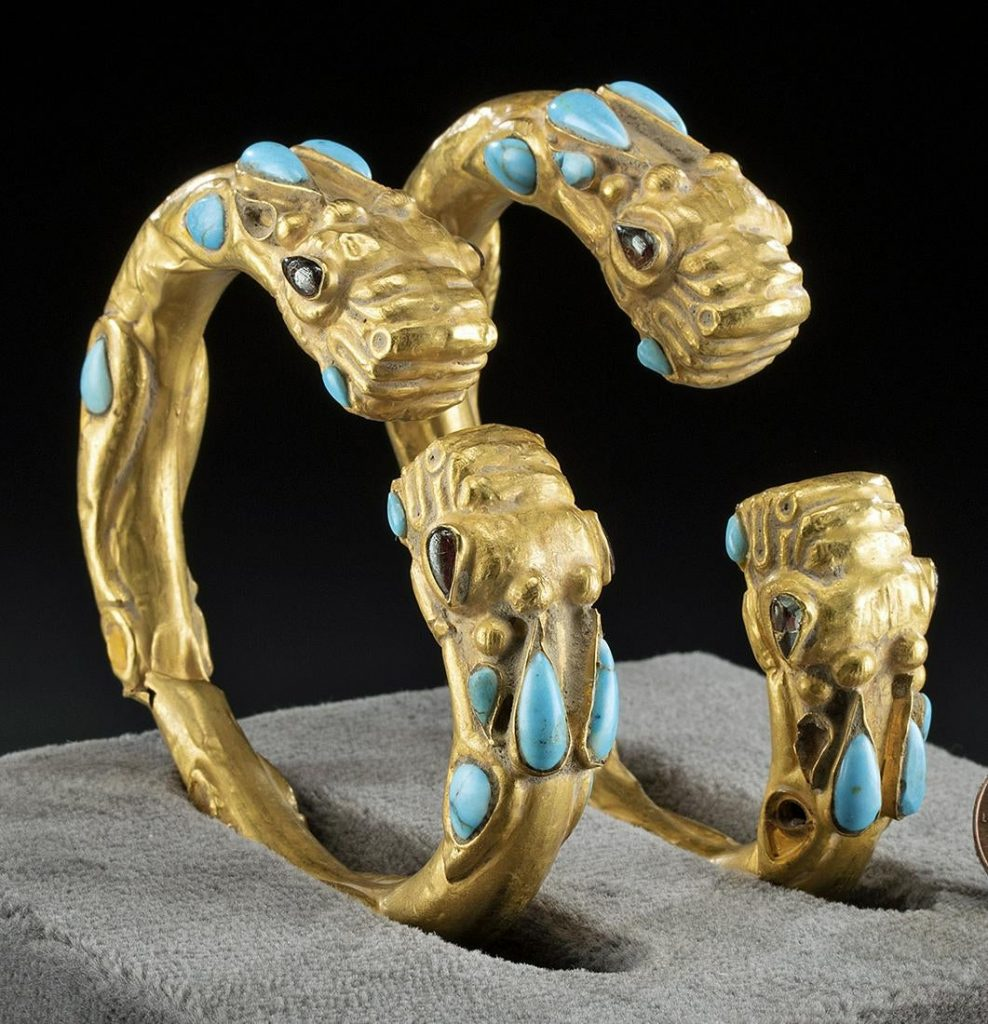 Achaemenid (Persian Empire) 22K gold bracelets of zoomorphic form with inlaid turquoise and garnets, circa 550-330 BCE, total weight 91.7g. Estimate $40,000-$60,000