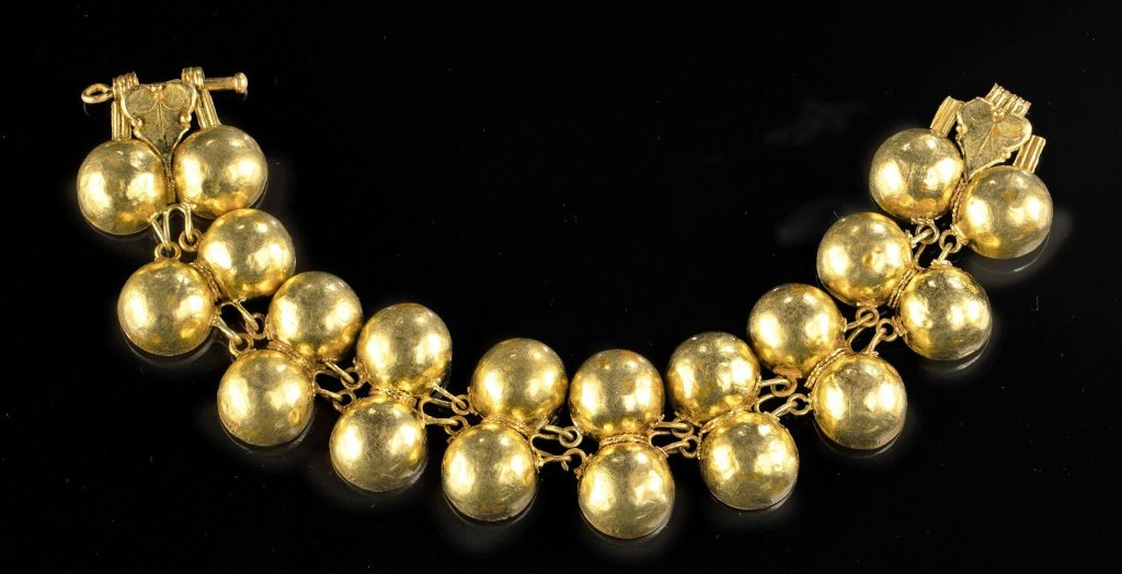 24K gold bracelet from the Roman Imperial Period, circa 1st century CE, 20 joined hemispherical gold bosses, total weight 60.9g. Provenance: private Utah collection, 1999 sale at Sotheby's. Estimate $18,000-$25,000
