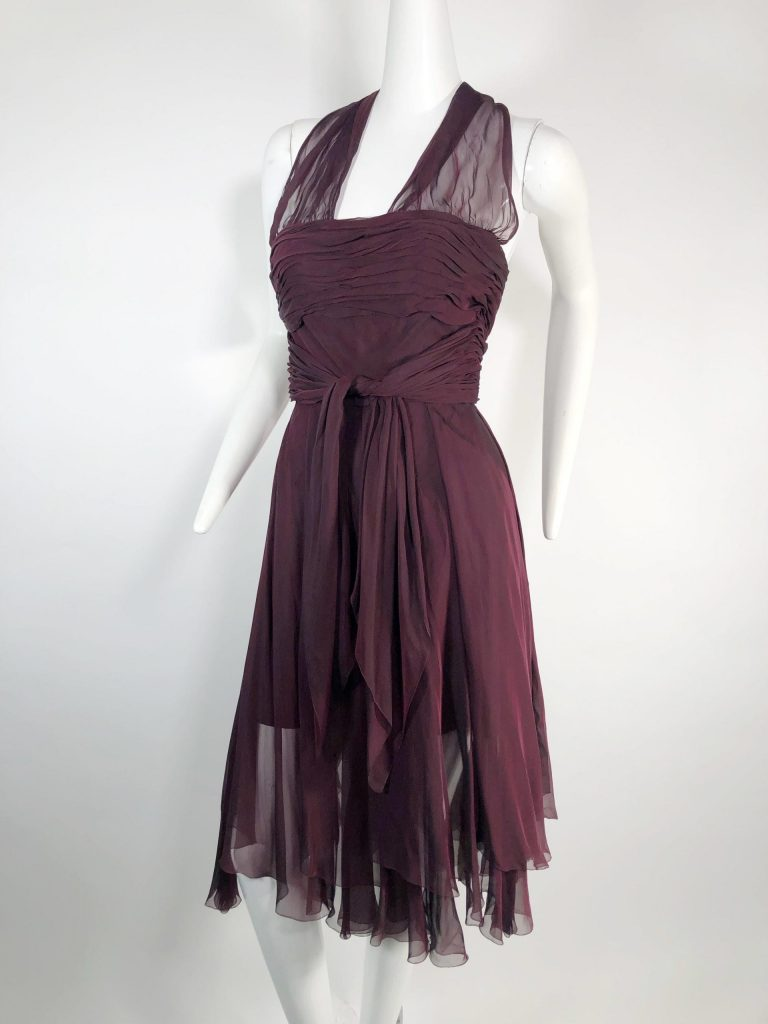 Chanel burgundy silk chiffon halter dress, 1990, with four matching, decorative Chanel monogram buttons at center back zipper. US size 4-6. Estimate $1,200-$1,500