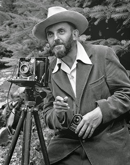 Ansel Adams with camera and light meter. Photo courtesy of Phaidon.