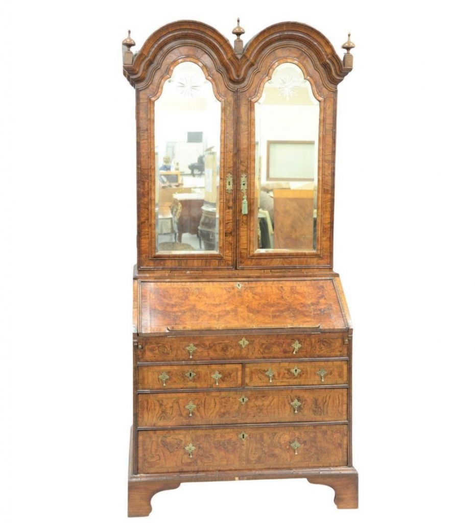 George I Figured Walnut Double-Domed Bureau Bookcase. Photo from Nadeau's Auction Gallery.