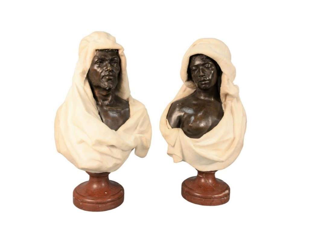 Busts of Tunisian Man and Woman by Leopold Bracony. Photo from Nadeau's Auction Gallery.