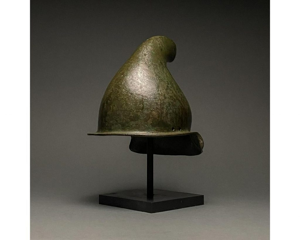 Rare Greek Hellenistic Phrygian bronze helmet, circa 500-300 BC, originally may have been associated with a statue of the god Attis. Provenance dates back to 1897 purchase by Jorg Krause. Fully authenticated with XRF Certificate from Belgian laboratory and 2020 European Export license. Estimate £30,000-£50,000
