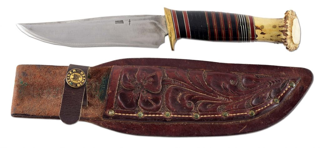 Recurved Scagel hunting knife, 1929-1931, crown stag pommel, double-stamped kris and W. SCAGEL/HANDMADE stamp. Hand-tooled leather sheath with HEISER/DENVER button. Provenance: Dr. James R. Lucie personal collection. Estimate $8,000-$15,000