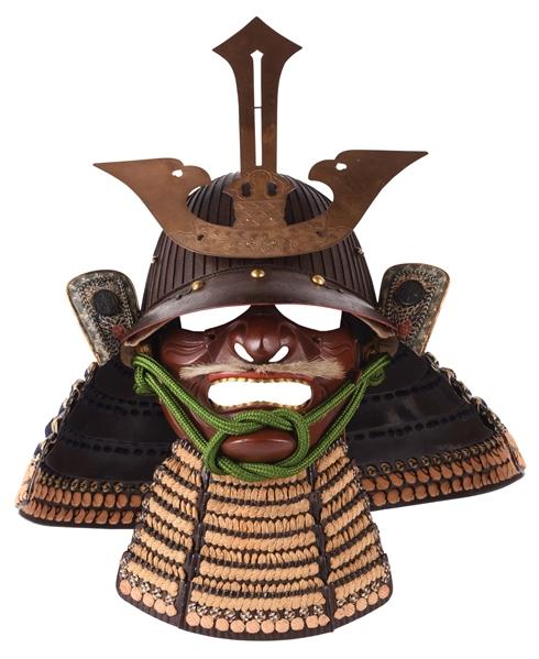 Japanese kabuto (warrior's helmet) with 69 'ken,' or iron plates; menpo, fukigaeshi, three-lame shikoro. Estimate $5,000-$8,000