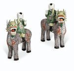 A LARGE AND RARE PAIR OF FAMILLE VERTE BOYS RIDING QILIN