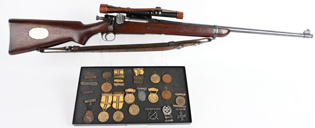 1903 US Springfield Presidents Match Trophy rifle, 30-06 caliber, awarded to USMC Gunnery Sgt. John Thomas, the first Marine to win this highly coveted award. Of five examples made, this is one of only three whose whereabout are known. Accompanied by 16 shooting medals and ribbons, plus ephemera. Estimate $20,000-$30,000