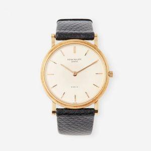 An eighteen karat gold strap wristwatch, Patek Philippe, retailed by Gubelin, Calatrava, circa late 1960's