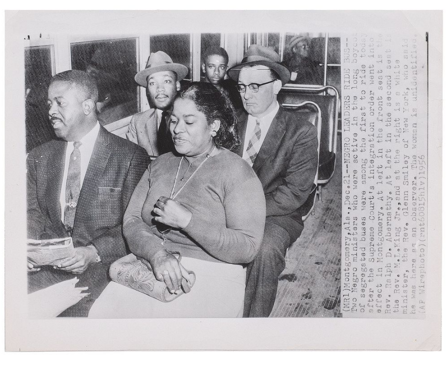 Press photograph of African American leaders riding a segregated bus in December of 1956. Image courtesy of Cowan's Auctions.