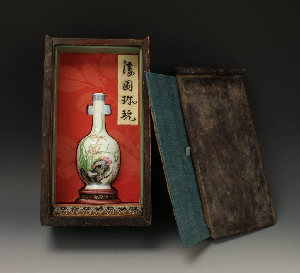 Beautiful hand-painted Chinese bottle vase in a handsome presentation box, 12 inches tall, with a painted garden on one side, calligraphy and an artist's mark on the reverse (est. $5,000-$8,000).