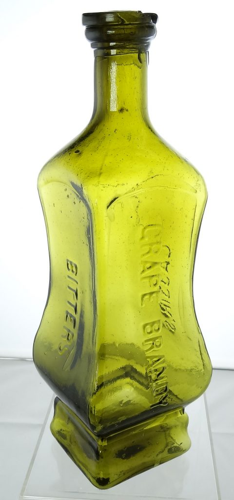 Cassin's Grape Brandy Bitters, circa 1866-1873 (C 78). This is a second variant example in a beautiful yellow-green color. It has an imperfectly formed top, but still grades well at 8.5.