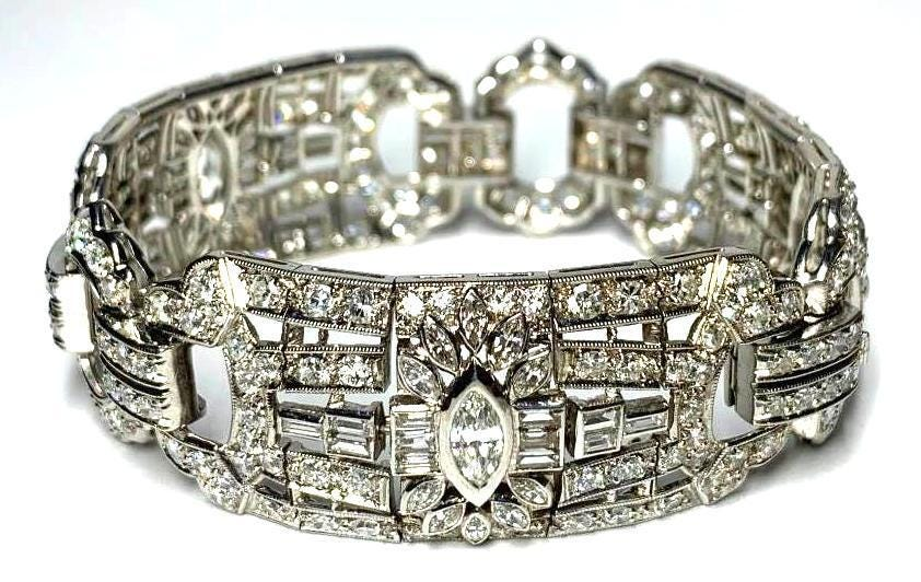 An expected top lot is this marked Art Deco period diamond and platinum bracelet with a bezel set central marquise diamond flanked by 12 channel set baguettes (est. $15,000-$20,000).