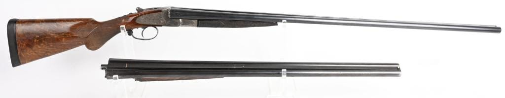 1913 L.C. Smith crown-grade 20-gauge ejector gun with both a 26-inch and 32-inch barrel. Made to order by Hunter Arms Co., Fulton, N.Y. One barrel is marked 'Sir Joseph Whitworth Fluid Compressed Steel.' Sold for $24,000 against an estimate of $3,000-$4,000
