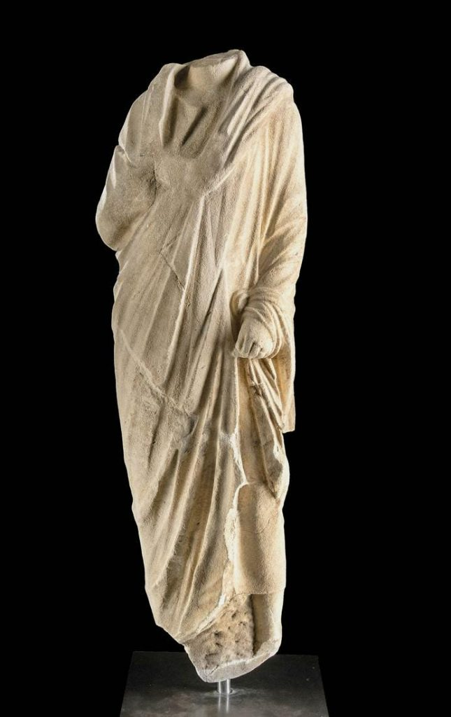 Carved life-size Roman marble togatus torso, Imperial Period circa 1st-3rd century CE, 53.5in high. Provenance: ex Merrin Gallery, New York, 1980s/'90s. Estimate $100,000-$150,000