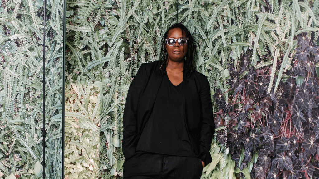 Mickalene Thomas at the Baltimore Museum of Art in 2019. Image from Andrew Mangum for The New York Times.